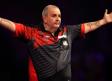 16-time world champion Phil Taylor celebrates his semi-final win over Jamie Lewis