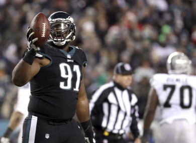 Philadelphia Eagles' Fletcher Cox reacts after a Oakland Raiders fumble.