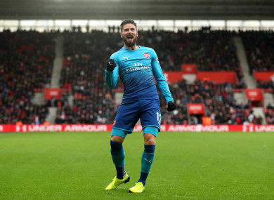 Giroud celebrates his late leveller.