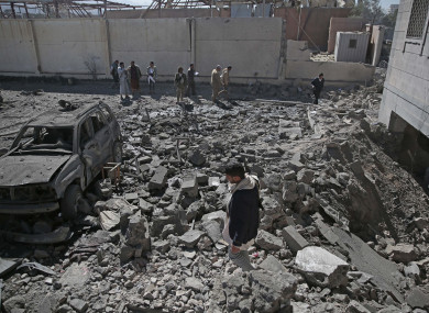 People inspect the rubble of a Houthi-held detention center destroyed by Saudi-led airstrikes in Sanaa, Yemen earlier this month.