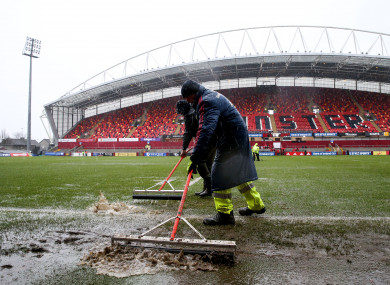 Ground staff are currently working to dry the surface.