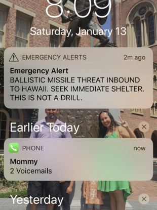 A smartphone screen show a false incoming ballistic missile emergency alert sent from the Hawaii Emergency Management System last week.