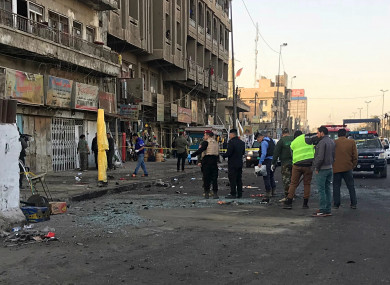 Iraqi security forces gather at the scene of a double suicide bombing in Baghdad, Iraq.