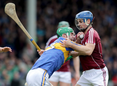 Noel McGrath and Johnny Coen in action in last year's hurling league final.