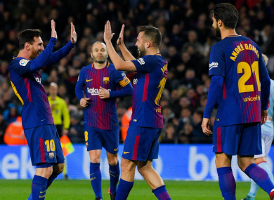 Messi leads celebrations with Jordi Alba.