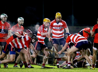 UCC and CIT players battle for possession during this evening's Round 1 clash