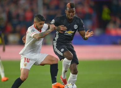 Sevilla midfielder Ever Banega and Paul Pogba of Manchester United.
