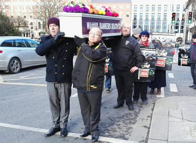 Protesters bringing a coffin to the door of PTSB today.