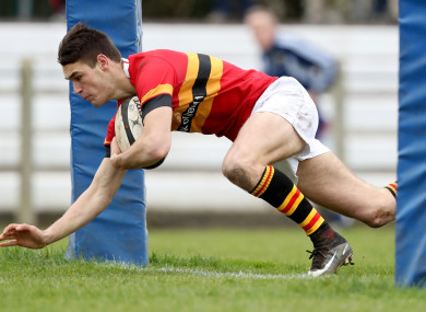 Eoghan Barrett scoring a try for CBC.