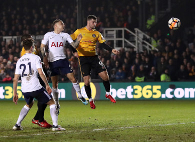 Newport County's Padraig Amond (centre) scores against Spurs.