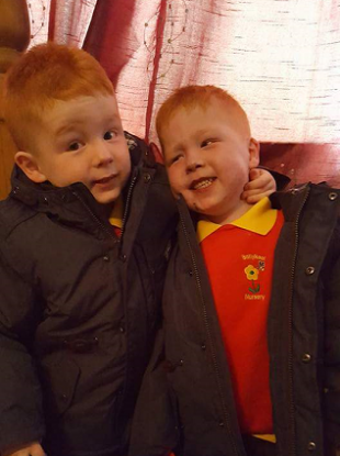 Kayden (right) with his twin brother Jayden