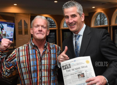 Reich poses with a newspaper next to Colts' owner Jim Irsay to prove he has really signed on.