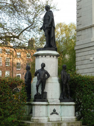 The statue is still in place on the grounds of Leinster House.