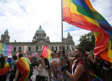 Participants pass city Hall as they take part in Belfast's annual Pride parade.