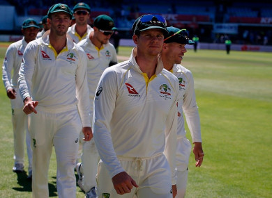 Australia's captain Steve Smith (centre) leads his team alongside David Warner (right).