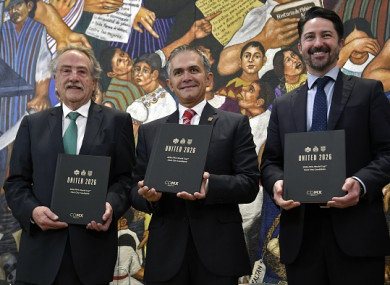 Decio de Maria (L), president of the Mexican Football Federation, Mexico City Mayor Miguel Angel Mancera (C), and Yon de Luisa (R), director of the joint bid for the next soccer 2026 World Cup in North America, pose for photographers.