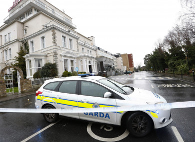 The sealed-off scene of the Regency Hotel, in the aftermath of the shooting.