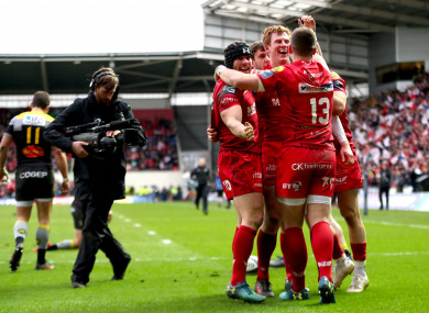 Halfpenny and Scott Williams celebrate with try scorer Patchell.