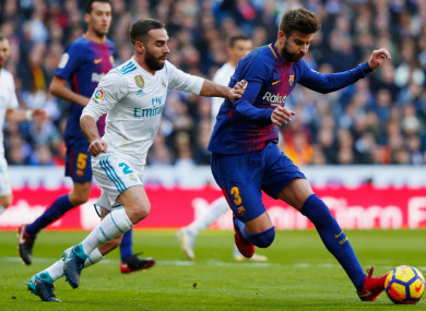 Real Madrid's Dani Carvajal and Gerard Pique of Barcelona.