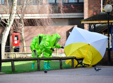 Members of the emergency services in green biohazard encapsulated suits following the attack on Sergei Skripal.