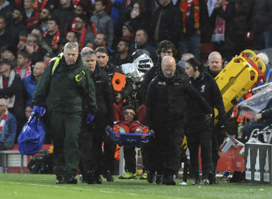 Liverpool's Alex Oxlade-Chamberlain is carried on a stretcher after getting injured.
