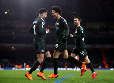 Manchester City's Leroy Sane (centre) celebrates scoring a goal.