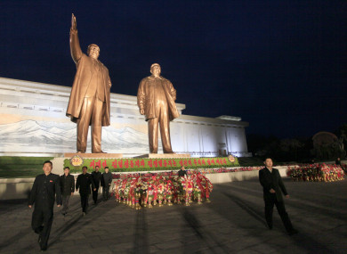 North Koreans visit the Mansu Hill to lay floral baskets and flowers to the statues of late leaders Kim Il-Sung and Kim Jong-Il