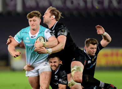 Peter Robb is tackled by three Ospreys players.