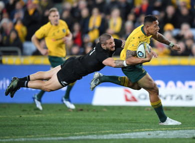 Perenara tackles Folau during the Bledisloe Cup last year.