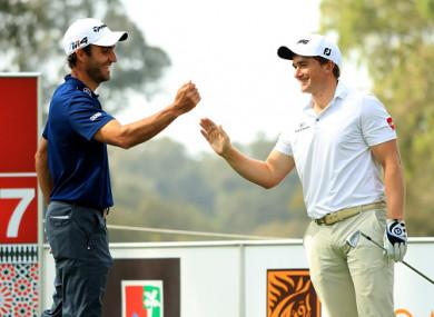 Dunne celebrates his ace with playing partner Edoardo Molinari.