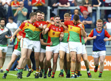Carlow players celebrate at the final whistle.