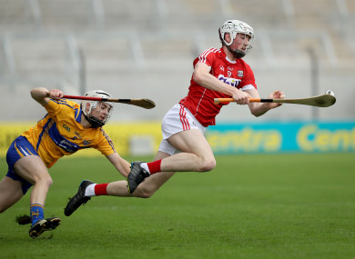 Clare's Fionn Slattery with Paul Cooney of Cork.