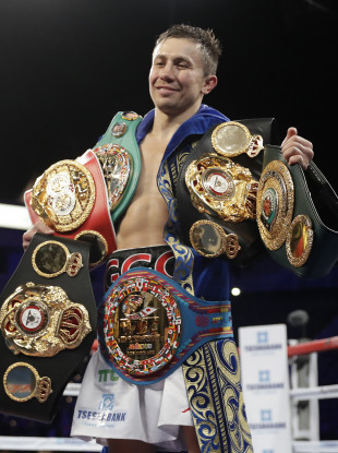 Gennady Golovkin poses with his belts after defeating Vanes Martirosyan.