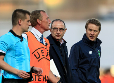 Republic of Ireland senior manager Martin O'Neill and Under 17 manager Colin O'Brien speak with referee Zbynek Proske after the match.