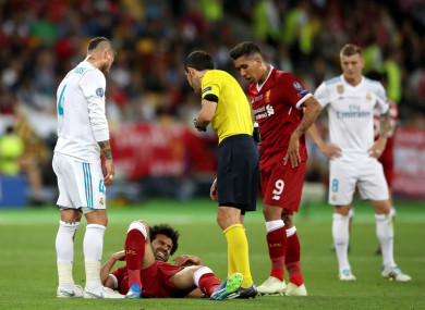 Liverpool's Mohamed Salah has departed the action with a shoulder injury.