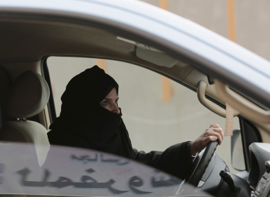 File: Aziza al-Yousef drives a car on a highway in Riyadh, Saudi Arabia, as part of a campaign to defy Saudi Arabia's ban on women driving.