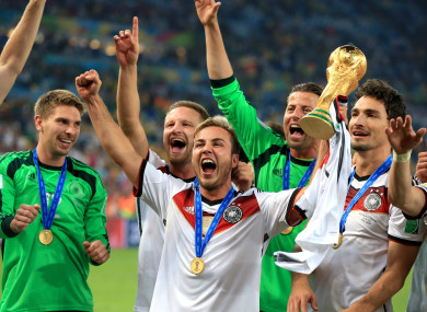 Gotze lifts the World Cup trophy alongside German team-mates four years ago.