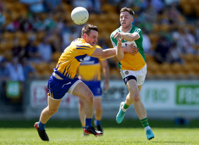 Offaly's Cian Donoghue (right) and Eoghan Collins of Clare.