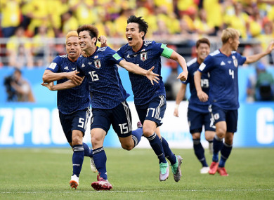 Yuya Osako celebrates restoring Japan's lead in the second half.