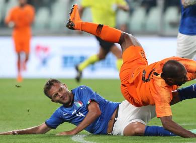 Italy's Domenico Criscito fouls Netherlands' Ryan Babel