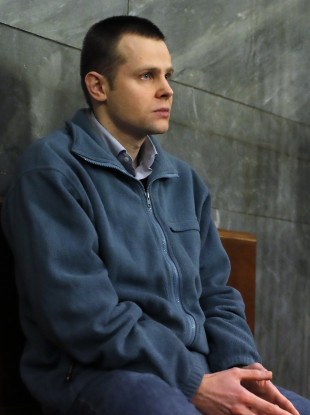 Lukasz Herba sits at a Milan court in Italy during his trial.
