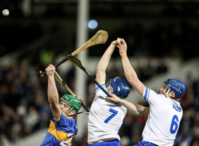 Paul Shanahan under pressure from Kieran Bennett and Austin Gleeson when the teams met in the League in February.