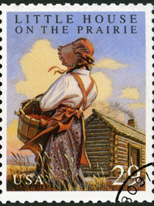 A stamp printed in USA shows Little House on the Prairie by Laura Ingalls Wilder - File photo