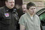 Brendan Dassey being escorted out of a Manitowoc County Circuit courtroom in Wisconsin in March 2006