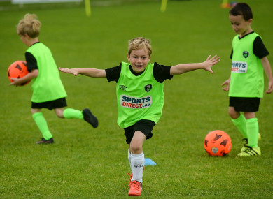 Taking the lead at the FAI Summer Soccer School.