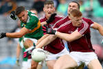 Michéal Burns is blocked out by the Galway defence.