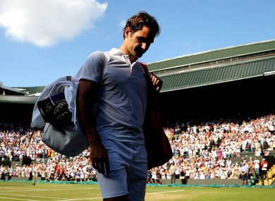 Roger Federer walks off court after losing to Kevin Anderson
