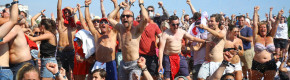 Fans on Brighton beach celebrate England's win over Sweden.