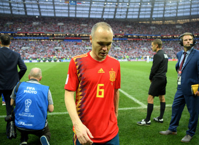 Iniesta leaves the pitch following Spain's defeat to Russia on Sunday.