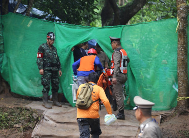 Rescuers work near the cave where the young soccer team members and their coach were trapped in Chiang Rai, Thailand